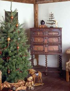 Simply Christmas...gorgeous old furniture piece with feather tree and old jug...