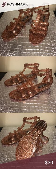 Urban Outfitter gladiator jelly sandals Never worn! Size 37. Brand new from urban outfitters. Fun metallic pink color with glitter. Comes with cloth storage bag. Looking for a new home 💕 Urban Outfitters Shoes Sandals