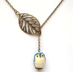 How darling is this @Caitlin Burton Colombo!  Antiqued Brass Leaf Blue Owl Necklace