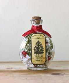 Christmas Tree in a Jar Decorative Christmas Apothecary Bottle. $16.00, via Etsy.
