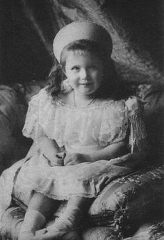 Grand Duchess Anastasia dressed for her brother Alexei's christening and looking rather impish about it. 1904.