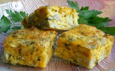 Petite baked appetizer squares made with egg, cheddar cheese, marinated artichoke hearts, green onion, parsley and crumbled crackers. Marinated Artichoke Hearts Recipe, Artichoke Heart Recipes, Appetizer Recipes, Christmas Appetizers, Crepes, Egg Recipes, Cooking Recipes, Vegetarian Recipes, Gourmet
