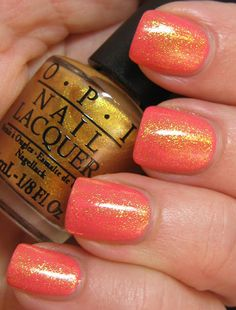 Loving this orange with gold flecks shade by OPI... #nails
