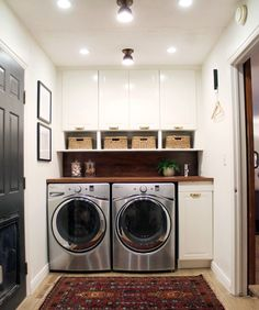 Great set up for a laundry room. Love the washer and dryer with the basket shelves above. I wonder if there is a laundry sink on the other side of the room?
