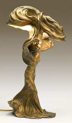 Photo of a Loie Fuller Cast Bronze & Fire Guilded Lamp by Raoul Larche. I saw this piece in the Morse Museum and its even more stunning in real life. I love the sense of movement.