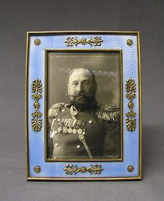 Picture frame by Carl Fabergé, workmaster: Julius Rappoport, before 1899, in silver-gilt and sky blue guilloche enamel