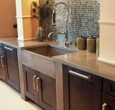 Concrete countertop with concrete sink.  Love the wall of mini tile behind the sink where it always gets so nasty and splashed.