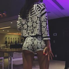 Whoa! Kendall Jenner flashes a little booty in the shortest shorts possible.