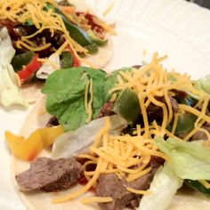 Delicious Steak Fajita Stir Fry on Corn Tortilla-   steak, onion, garlic, adobo seasoning, green, yellow, and orange peppers.