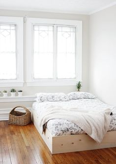 I've been pinning lots of bedrooms that have the bed laying right on the floor piled with cozy blankets and pillows. I recently got a new mattress and didn't want to buy a bed frame for it so I left it on the floor for a few months. I couldn't stand seeing the boxspring peeking …