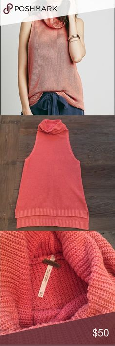 "Free people sleeveless sweater Sleeveless sweater excellent condition. Worn once only. Large exaggerated arm holes. Great for a warm fall day. Washed sienna color so like a Coral. Roll neck. About 22"" to hem in front and 24"" in back. Free People Sweaters"
