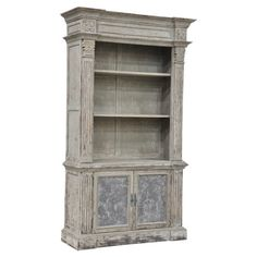 A perfect addition to your living room or study, this pine wood bookcase showcases 2 removable shelves and 2 bottom doors.   Produc...