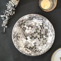 Perfect for adding a bit of glitz and glamour to your party or New Year's Eve celebration, these disco ball design shiny foil paper plates are certain to attract your party guests' attention. Each pack contains 12 paper plates measuring in diameter.