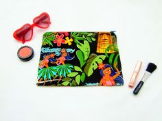 Make up bag, tiki kitsch fabric, Hawaiian fabric bag, hula girl pouch, holiday cosmetic bag, beach holiday bag, tiki head fabric, cute pouch by Kitschosaurus on Etsy