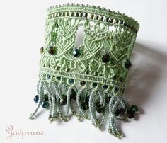 Pale green lace cuff bracelet by French micro-macramé artist MarieClaire Vastra (aka Zoeprune). This is such an attractive piece. She does a lovely job of emulating lace. Nice color combos throughout. Besides, who doesn't like a little bit of fringe? Macrame Necklace, Macrame Jewelry, Macrame Bracelets, Micro Macramé, Jewelry Knots, Knitted Flowers, Macrame Design, Macrame Projects, Macrame Tutorial