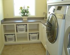 sink next to washer/dryer then folding counter with baskets underneath for each person's clothing. I have thought of this for ages...completely in my home plans.