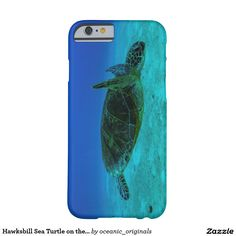 iPhone 6 case featuring a close up view of a Hawksbill Sea Turtle swimming in the clear blue waters of the Coral Sea on the Great Barrier Reef off the coast of QLD, Australia.