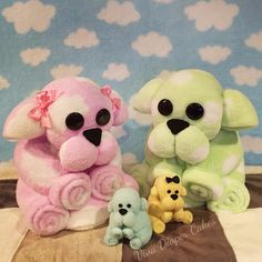 """Fluffy blankie puppies modelled after washcloth puppy pattern . Makes a great stand alone gift , diaper cake topper , or order a family with baby washcloth puppies .  Not all designs are uploaded to our Pinterest board. Please """"like"""" our page on facebook if you like our designs and would like to see more.   www.facebook.com/vivadiapercakes"""