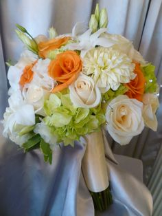 Bridal bouquet with Green Hydrangea, Orange Mambo Roses, Vendela Roses, White Lisianthus, White Dalias, White Dendrobium Orchids and Rhinestone Sprays | Walden Floral Design