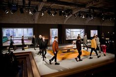"""OMA_PRADA Catwalk Man/Woman FW 2013 // The audience faces an """"ideal house"""": an interior populated with geometric furniture, objects and manifestations of everyday life. The models weave through this set, acting as characters in a sequence of sophisticated domestic scenes."""