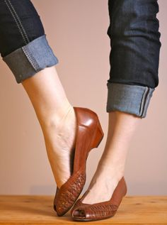 Brown leather wedges.