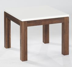 "End/Lamp Table  A ""mini-me"" of the coffee table, similarly comprising a solid American black Walnut frame with a high gloss white top. Dimensions: W600mm x D600mm x H500mm"