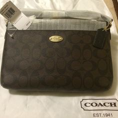 "NWT Coach East/West Pop Crossbody Signature canvas with leather trim. Inside open pockets. Zip closure, fabric lining . Removable pouch. Double strap with 22 3/4"" drop for shoulder or crossbody wear  10 1/2"" (L) x 6 3/4"" (H) Matching checkbook wallet also listed in my closet. Coach Bags Crossbody Bags"