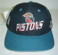 "New! Logo Athletic NBA Detroit Pistons Snapback Cap w/ Teal Blue & Black Grid Design by SLD. $9.75. Made by Logo Athletic. 80 % Acrylic 20% Wool. Adult Sized Flatbill Snapback cap. Adjustable plastic snap back strap. Officially Licensed Product of the NBA. This cap has a teal blue and black grid design with a teal visor.  ""Pistons"" logo is very nicely embroidered on front panel of hat.  Logo Athletics logo on the left side.  NBA logo on the right side."