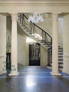 Elegant over-the-door circular staircase in Georgian Revival style home, Atlanta, Georgia