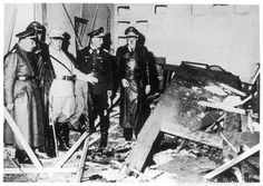 Hermann Goering (in white) showing officials, including Borman the wreckage following the failed July bomb plot to assassinate Hitler. Date: July 1944  https://sites.google.com/site/warrenbellauthor/