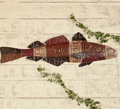 metal fish art made from painted repurposed license tags