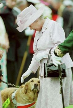 Her Majesty is introduced to Quorn the guide dog during Her tour of the garden party at The Palace of Holyrood in Edinburgh, 1999