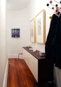 long white hallway with fauxdenza, art, hang-it-all, ant chair
