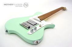 Annabelle - Surf green satin finish, Bocote fingerboard, 28 frets, 25.5 scale length