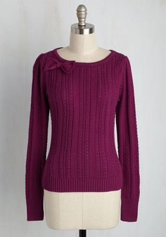 When you enter the scene in this cable knit sweater, the current convo pauses and turns to your terrific style! One friend gabs about the glorious magenta hue of this pullover, while another blabbers excitedly about the bow at its neckline. You, personally, adore the comfy cotton construction of this warm wear!