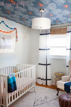 Modern Blue and Orange Nursery - love this clean aesthetic with a funky wallpapered ceiling!