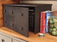 Microwave cover. That is a clever way to disguise a microwave and make it match any type of decor