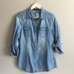NWT chambray shirt Staple chambray button up! NWT, size LG but fits like a MD/LG. Slightly longer in length, perfect for leggings! Tops Button Down Shirts