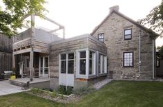modern cube addition to historic stone building