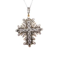 19th century diamond cross pendant, c.1830 , the arms set with cushion shaped stones, in a foliate scroll frame set throughout with smaller stones, diamond set hoop, open set in silver and gold