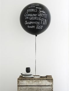 Use metallic marker on black balloon for month old picture...two balloons for two month?