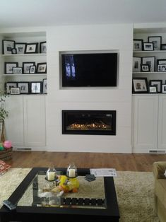 fireplace and TV with ship lap More