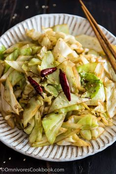 Infuse the oil with aromatics and then toss at a high heat, this adds a smoky flavor to the sweet fried cabbage and makes a quick and delicious side dish.