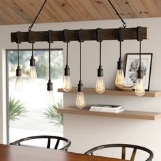 """null Add some modern-farmhouse light above your kitchen island or dining table with this bulb pendant. Hanging from two adjustable cords is a 48"""" long rectangular metal rod from which eight sockets dangle from nylon ropes. The alternating bare 60W bulbs (not included) hang from the pendant and will throw light throughout your space. This pendant light can be installed on a dimmer switch so you'll always have the right amount of light from morning to night. Plus, it can be hung on a sloped…"""