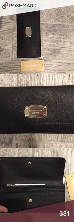 NWT AUTHENTIC MICHAEL KORS WALLET!!! Authentic! Black with the Michael KORS emblem in silver. Great style wallet! It's slim but plenty of space to keep you organized and to fit your necessities! I will ship it within 24 hours of your purchase! Michael Kors Bags Wallets