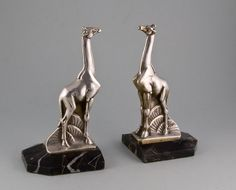 """Pair of Art Deco giraffe book-ends by Maurice FRECOURT.   A lovely pair of silvered bronze giraffes on shaped marble bases. Both pieces signed Frecourt. French circa 1925. H. 20 cm. Maurice FRECOURT, born in 1890 near Paris, sculptor, was the pupil of VALTON and BOUCHER. He exhibited his works at """"le Salon des Artistes Franais"""" from 1920. £1,500.00 the pair.  (hva)"""