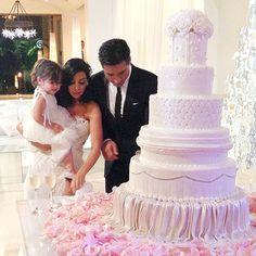 The Ultimate Celebrity Wedding Cakes | MARIO LOPEZ & COURTNEY MAZZA | One of the sweetest moments at the Extra host and his new wife's 2012 wedding was when they cut the cake with help from their 2-year-old daughter, Gia. The five-tiered pink creation, baked by Cake Boss's Buddy Valastro, had a winter-wonderland-meets-beach theme, perfect for a December wedding held in Punta Mita, Mexico.