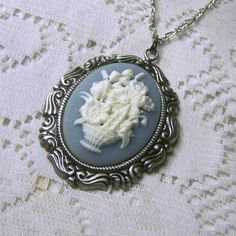 Flower Bouquet Cameo Necklace - Wedgewood Blue and White - Flower Basket by SouthernBelleOOAK on Etsy https://www.etsy.com/listing/115177782/flower-bouquet-cameo-necklace-wedgewood