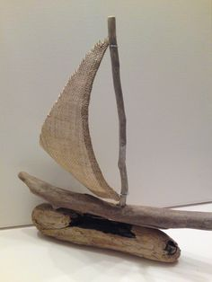"Chios - Driftwood sailboat with burlap sail- ready to ship -12"" x 12"". $35.00, via Etsy."