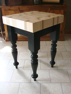 A butcher block table made by Century Porch Post including table legs from our stock patterns.
